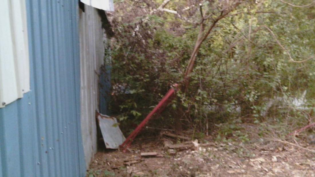 Behind barn